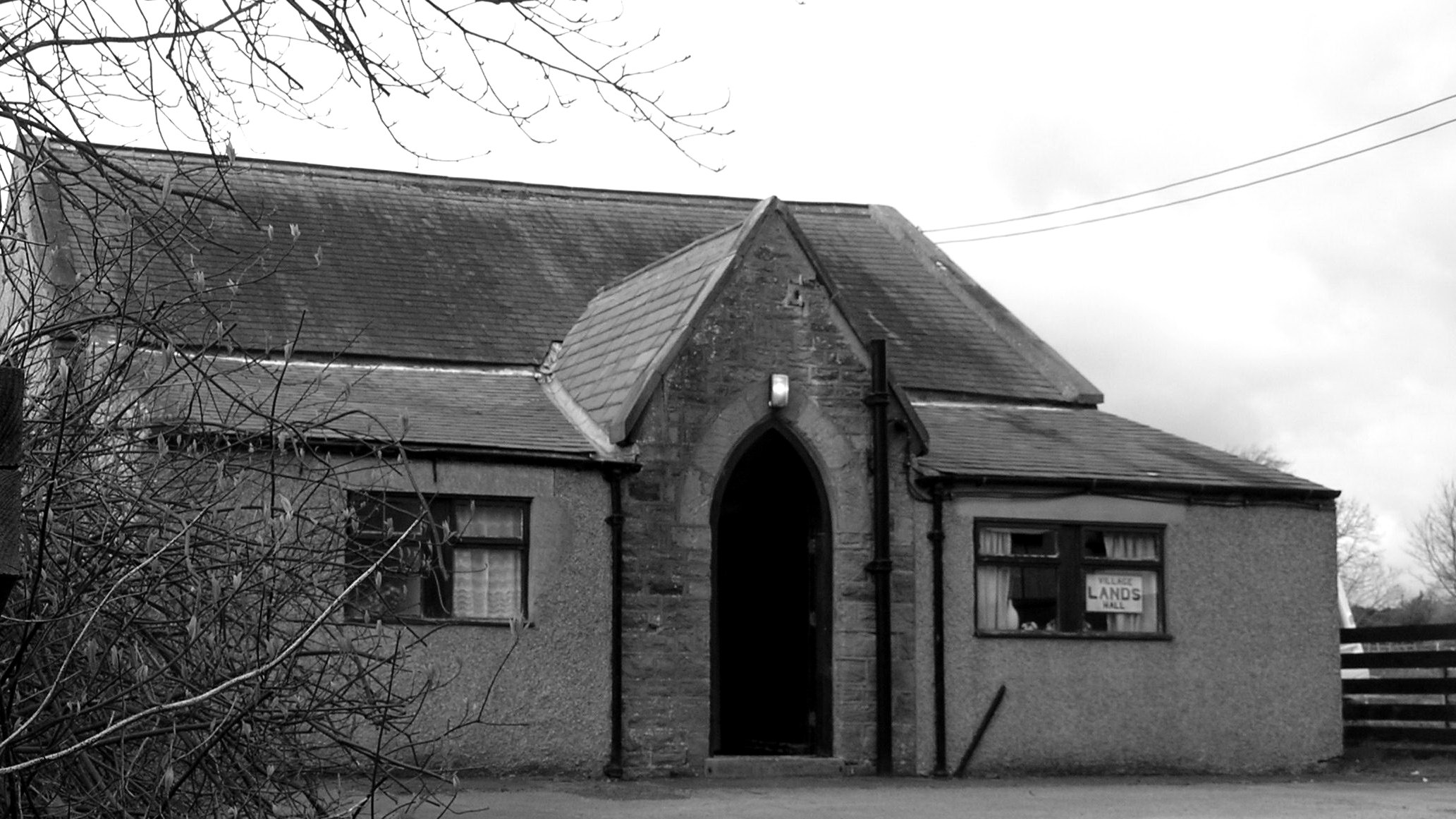 External photograph of Lands Village Hall in monochrome