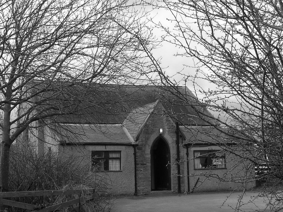 External view of Lands Village Hall in monochrome